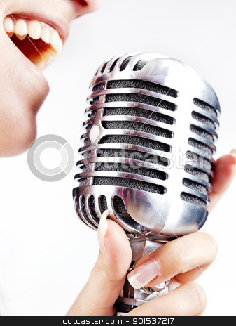woman singing on retro microphone stock photo, woman holding big retro microphone for singing by iMarin