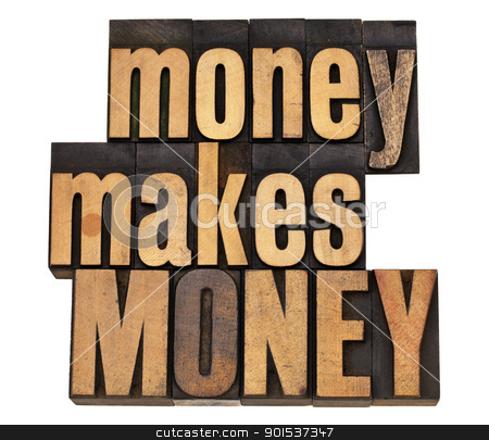 money concept in wood type stock photo, money makes MONEY - financial concept - isolated text in vintage wood letterpress type by Marek Uliasz