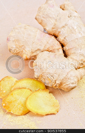 ginger stock photo, Fresh, dried and powdered ginger at brown background by olinchuk