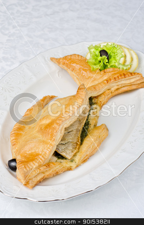 tasty dish of trout fish stock photo, tasty dish of trout fish baked with greens at dough by olinchuk
