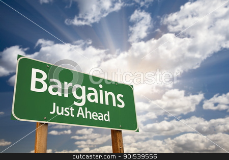 Bargains Just Ahead Green Road Sign and Clouds stock photo, Bargains Just Ahead Green Road Sign with Dramatic Clouds, Sun Rays and Sky. by Andy Dean