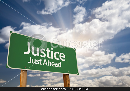 Justice Just Ahead Green Road Sign and Clouds stock photo, Justice Just Ahead Green Road Sign with Dramatic Clouds, Sun Rays and Sky. by Andy Dean