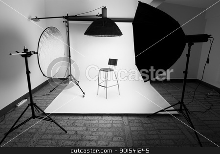 Photo studio stock photo, Photo studio setup with lighting equipment by Rafal Stachura
