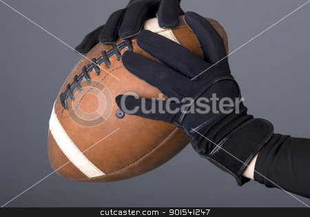 American football player stock photo, American football player holding ball by Tiramisu Studio