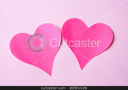 Two Hearts stock photo, Two hearts isolated on pink background by Tiramisu Studio