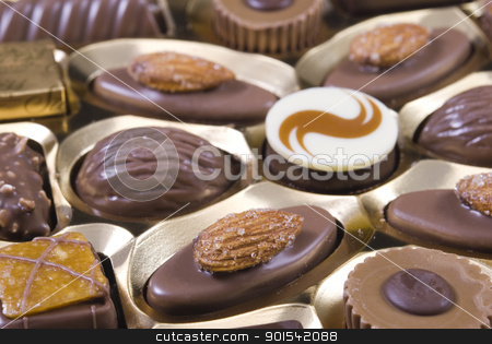 Selection of chocolates stock photo, Selection of milk, dark and white chocolates with almonds and toppings by Rafal Stachura