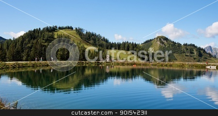Two hills reflecting in pond stock photo, Two hills reflecting in pond by Shlomo Polonsky