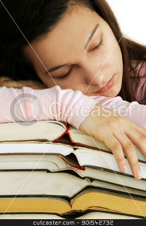 Tired girl sleeping on books stack stock photo, tired caucasian teenage girl portrait sleeping on books stack by Julija Sapic