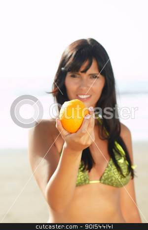 women offering you an orange stock photo, sexy  women offering you an orange on the beach by pablocalvog