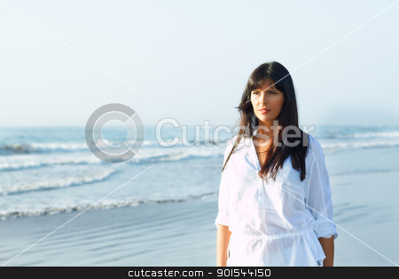 girl walking along the seashore stock photo, portrait of a sexy girl  walking along the seashore by pablocalvog