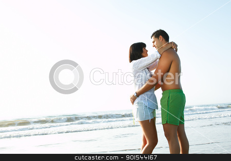 oving couple embracing  each other stock photo, portrait of an adorable  loving couple embracing  each other on the edge of  the beach by pablocalvog