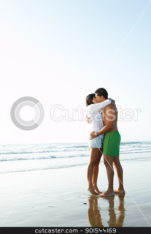 adorable  couple in love kissing and embracing each other stock photo, portrait of an adorable  couple in love kissing and embracing each other on the edge of the beach adorable  couple in love kissing and embracing each other on the edge of the beach by pablocalvog