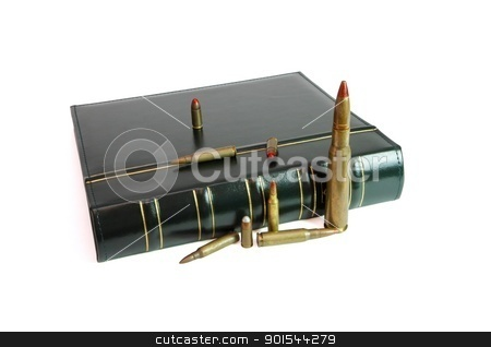 Dark book and cartridges of various calibers isolated stock photo, Dark book and cartridges of various calibers isolated by Shlomo Polonsky