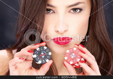 woman and gambling chips stock photo, Close up of a pretty woman holding gambling chips by iMarin