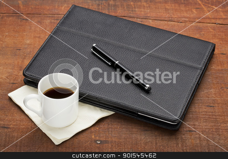 tablet computer with coffee stock photo, tablet computer in leather case with stylus pen and a cup of espresso coffee on old old grunge wood table by Marek Uliasz