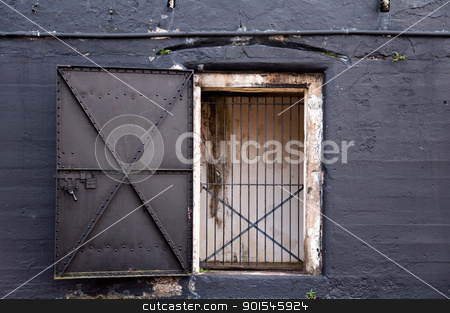 Historic Fort Doorway stock photo, A double doorway entrance into a historic fort near Charleston, South Carolina. Includes a large metal door on a black background. by Cathryn Gray
