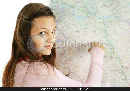 Teenage girl pointing at map stock photo, happy caucasian longhaired teenage girl pointing at map by Julija Sapic