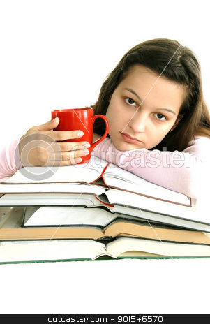 Teenage girl with books and tea stock photo, caucasian teenage girl sitting at the desk with stack of opened books and tea cup by Julija Sapic