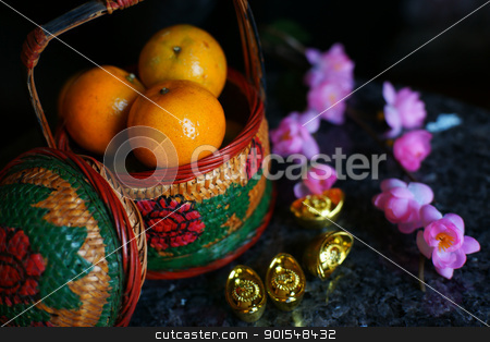 Chinese new year decoration stock photo, Basket of Apples and Oranges with Gold ingots and plum blossom by pixs4u