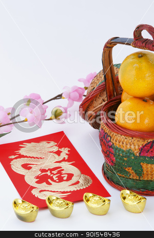 Chinese new year decoration stock photo, Basket of Oranges with Gold ingots and blessing word by pixs4u