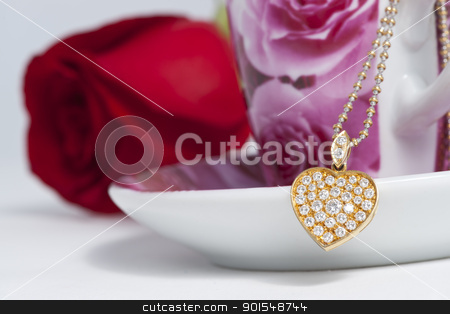 Diamond heart shape pendant and red rose stock photo, Diamond heart shape pendant and red rose by pixs4u