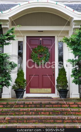 Magenta Door with Wreath stock photo, Magenta Door with Wreath on gray home with mossy red brick steps by bobkeenan