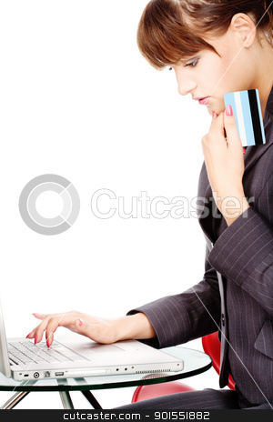 Shopping on line with credit card stock photo, Attractive business woman shopping on line with credit card, isolated on white by iMarin