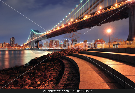 New York City Manhattan Bridge stock photo, New York City Manhattan Bridge closeup with downtown skyline over East River. by rabbit75_cut