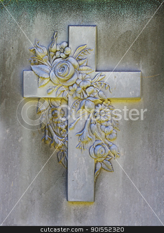 Stone carving of cross on a grave marker stock photo, Carving of Cross and Flowers from a Tombstone by ikehayden
