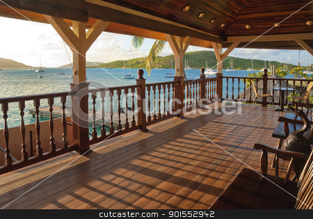 Tropical balcony stock photo, Tropical balcony in mahogany overlooking the caribbean by Christian Delbert
