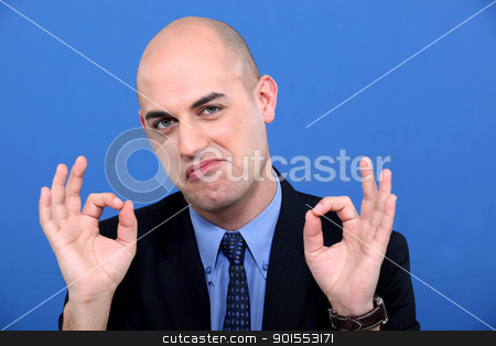 Man in suit making OK sign stock photo, Man in suit making OK sign by photography33