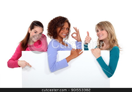 Women enthusiastically holding up a blank sign stock photo, Women enthusiastically holding up a blank sign by photography33