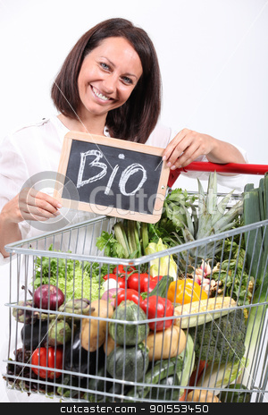 Woman with a trolley of organic vegetables stock photo, Woman with a trolley of organic vegetables by photography33