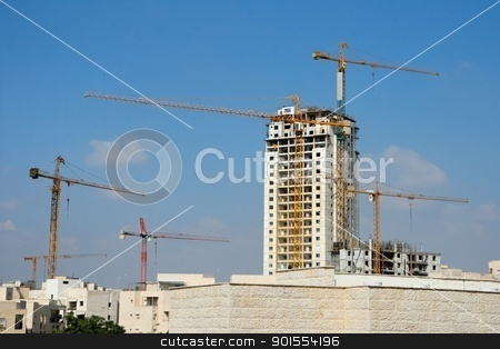 Six lifting cranes at construction site stock photo, Six lifting cranes at construction site by Shlomo Polonsky
