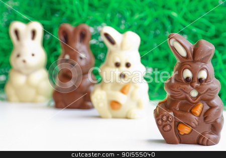black and white easter bunnies stock photo, black rabbit first before all- Chocolate Easter Bunny by manaemedia