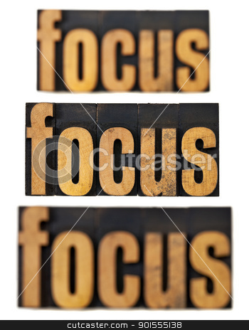 focus concept in wood type stock photo, focus word in and out of focus  - a collage of isolated text in vintage letterpress wood type by Marek Uliasz