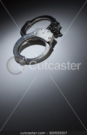 Abstract Pair of Handcuffs Under Spot Light - Text Room stock photo, Abstract Pair of Handcuffs Under Spot Light With Room For Your Own Text. by Andy Dean