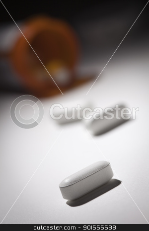 Medicine Bottle and Pills Under Spot Light stock photo, Medicine Bottle and Pills Under Spot Light Abstract. by Andy Dean