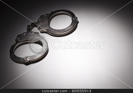 Abstract Pair of Handcuffs Under Spot Light - Text Room stock photo, Abstract Pair of Handcuffs Under Spot Light With Room For Your Own Text. by Andy Dean