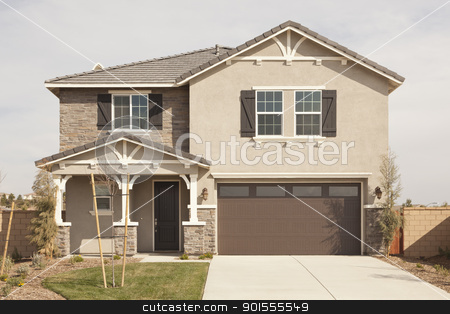 Newly Constructed Modern Home Facade stock photo, A Newly Constructed Modern Home Facade and Yard. by Andy Dean