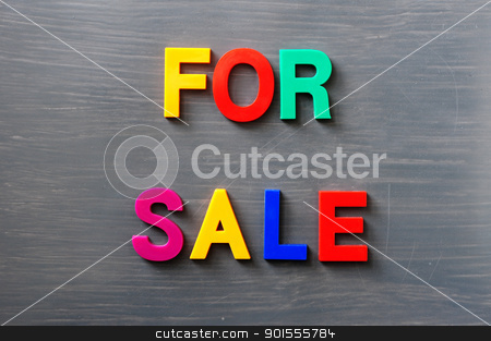 For sale stock photo, Words of For sale made of colorful letters on a gray board by John Young