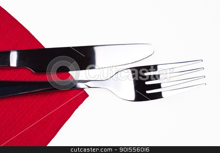 Knife and fork on red tablecloth isolated stock photo, Knife and fork on red tablecloth isolated close up by Nanisimova