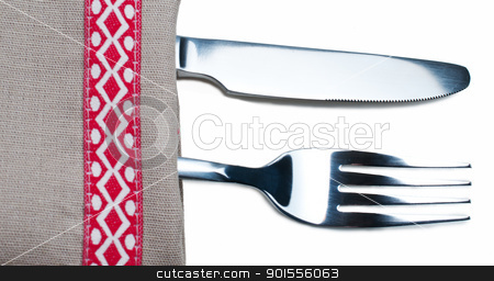 Knife and fork on gray napkin stock photo, Knife and fork on gray napkin close up by Nanisimova