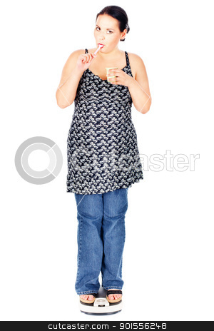 chubby woman eating on scale stock photo, chubby woman on the scale eating a yogurt, isolate on white by iMarin