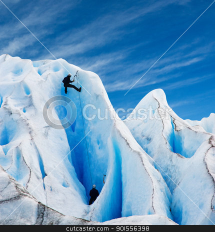 Two men climbing a glacier in patagonia.  stock photo, Two men climbing a glacier in patagonia. Copy space. by Pablo Caridad