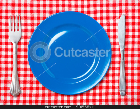 Blue dinner plate with fork and knife  stock photo, Empty blue dinner plate with fork and knife on red and white checked tablecloth. by Pablo Caridad