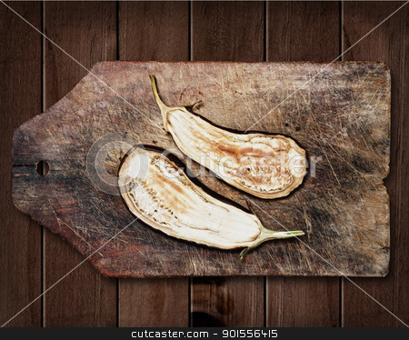 Grilled aubergine. stock photo, Grilled aubergine on wooden table. by Pablo Caridad