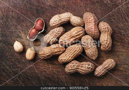 Peanuts on wood. stock photo, Peanuts background on a wooden table. by Pablo Caridad