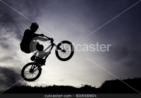 jump in the air stock photo, a biker doing attraction style with blue sky background by donalhusni