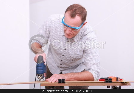 Cutting wood stock photo, Cutting wood by photography33